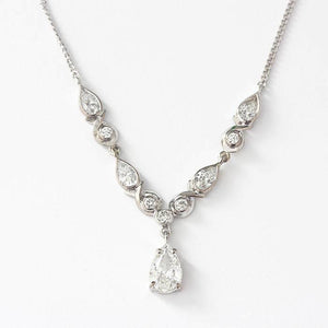 a pear shaped and brilliant cut diamond fringe drop pendant necklace in white gold 18 carat
