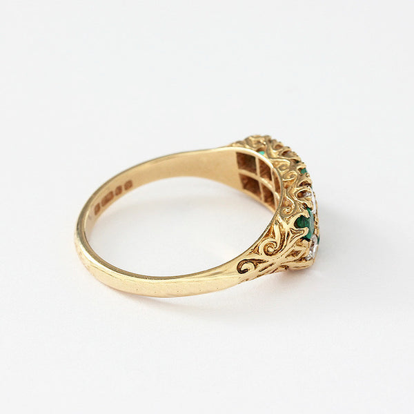 a yellow gold vintage secondhand emerald and diamond cluster ring
