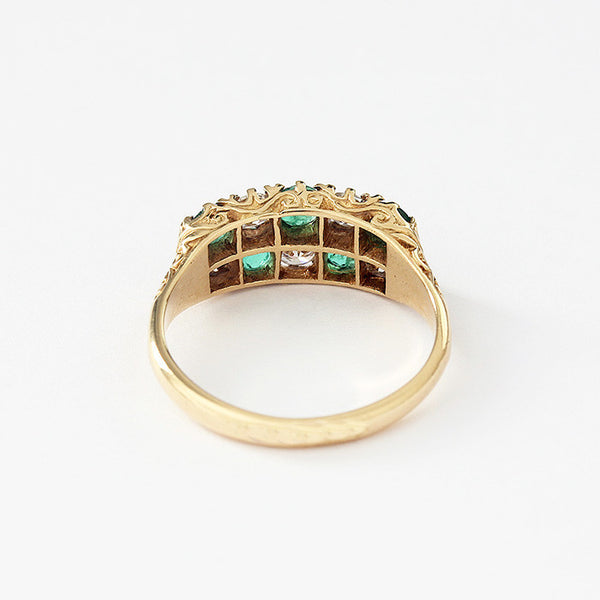 a secondhand emerald and diamond cluster ring in yellow gold
