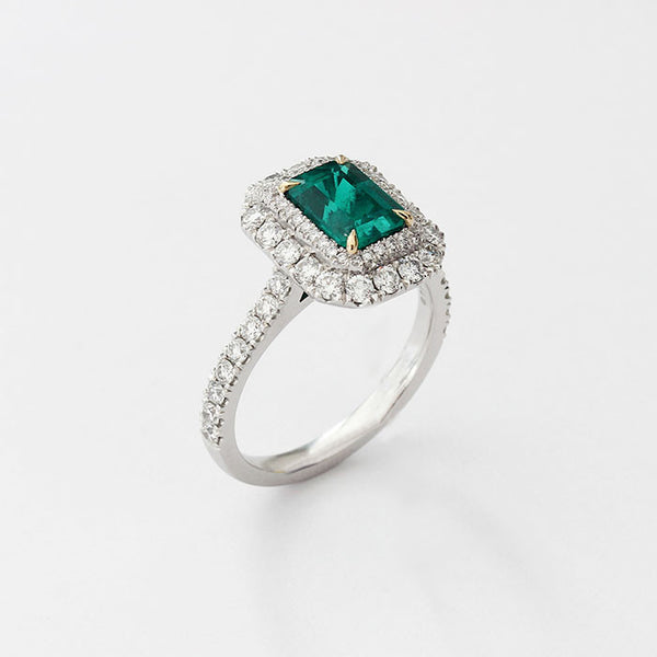platinum emerald and diamond modern cluster with diamond shoulders