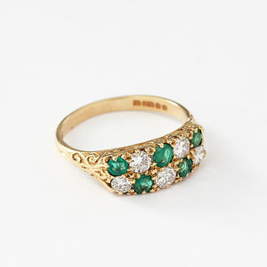 an emerald and diamond checkerboard design ring in yellow gold vintage 1970s
