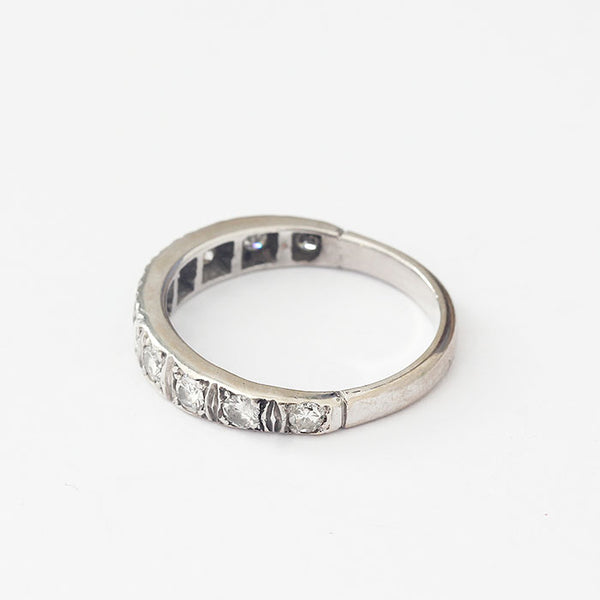 a platinum mounted diamond set three quarter eternity ring with 10 round diamonds