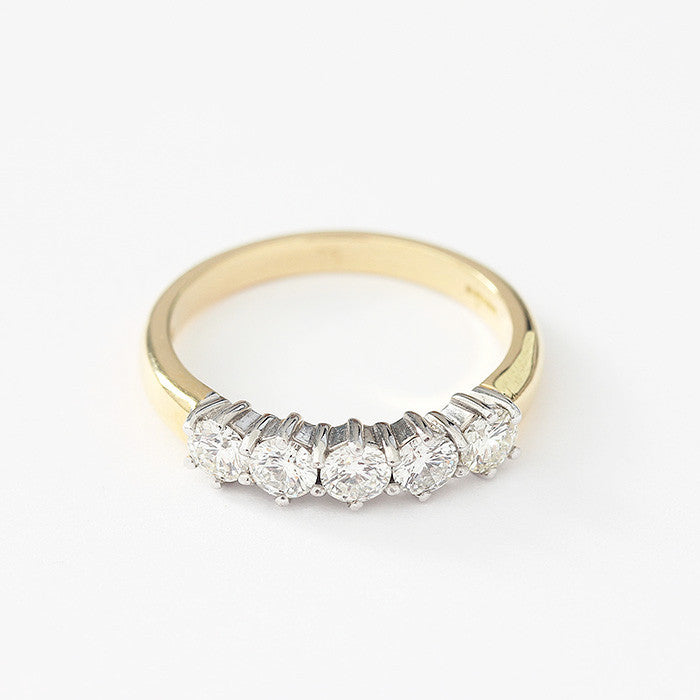 diamond set half eternity ring with claw setting and yellow band with white gold setting