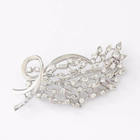 a diamond set spray brooch in white gold with baguette and round diamonds