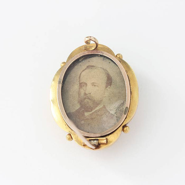 a beautiful yellow gold victorian brooch with a small central diamond and beaded design and photo of a gentleman