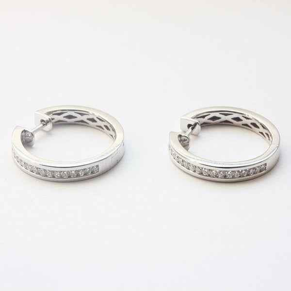 a pair of 18ct white gold diamond hoops with plain section and hinge
