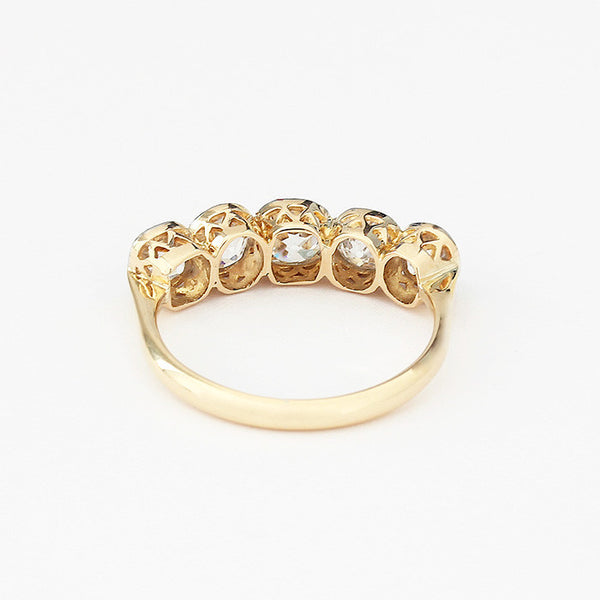 5 stone ring with old cut diamonds and set in yellow gold platinum