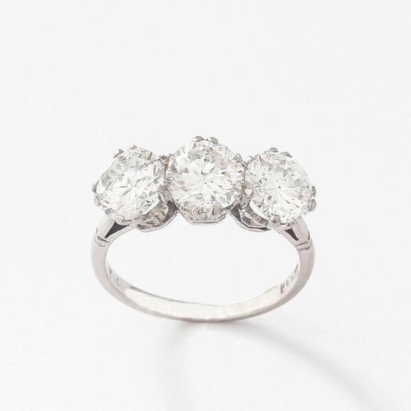 a diamond set 3 stone ring in platinum with 3 round stones totalling approximately 2.50 carat