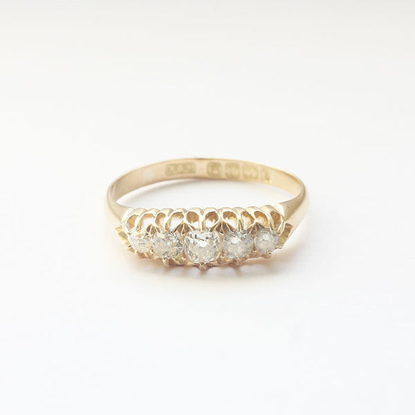 an 18ct yellow gold antique ring with old cut diamonds 5 in total