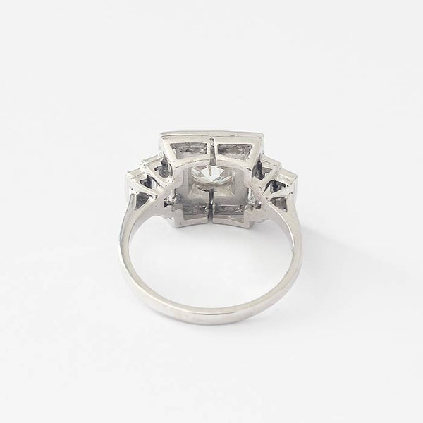 a beautiful diamond cluster ring with baguette stones and brilliant cut stones in a grain set in 18ct white gold