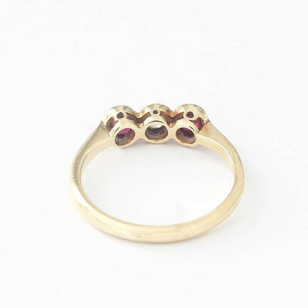 a secondhand yellow gold ruby and diamond 3 stone ring in a grain setting