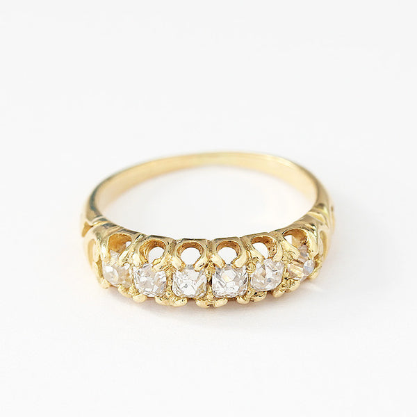 diamond set ring in yellow gold with scroll pattern