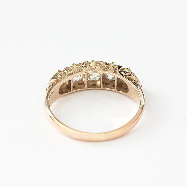 a 5 stone diamond ring with graduated stones in gold metal stamped 15ct