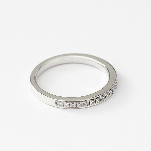 a platinum eternity ring with 17 small round diamonds in a channel setting