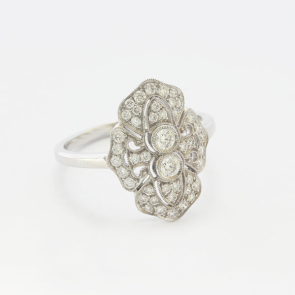 a beautiful cluster art deco style ring in white gold