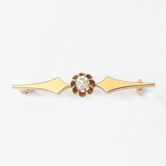 a round old cut diamond set brooch with yellow gold plain sides