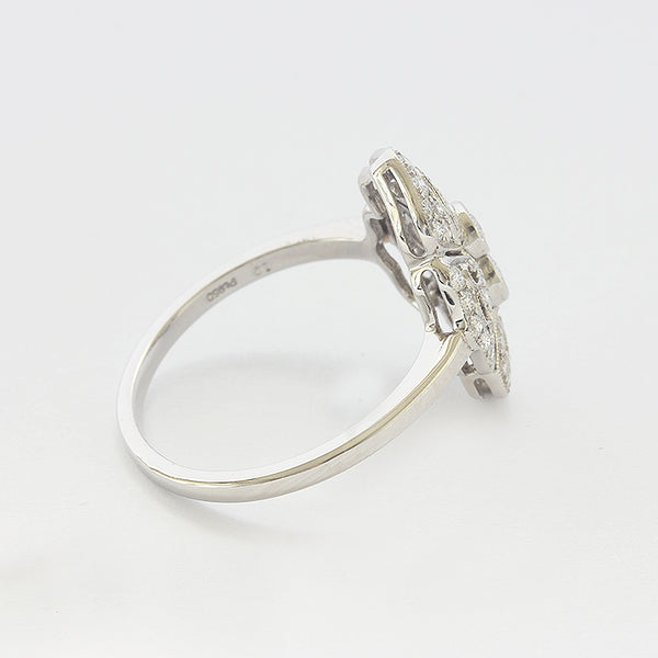 a white gold art deco cluster design ring with diamonds