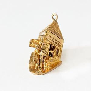 a man swinging round lamp post charm large in size and 9ct yellow gold