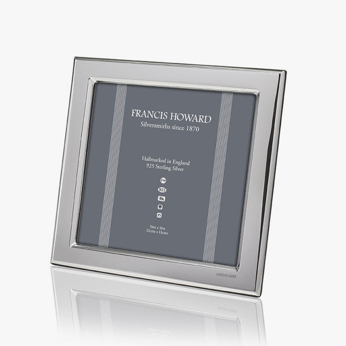 silver photo frame which is square in shape and plain edge with wooden back