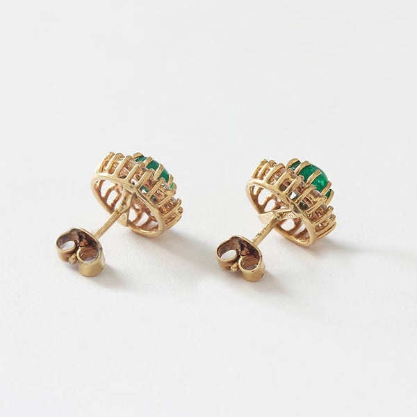 18ct yellow gold claw set round cluster stud earrings with a central emerald and a surround of little diamonds