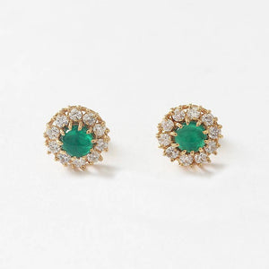 round emerald and diamond cluster stud earrings in a claw setting all made in yellow gold
