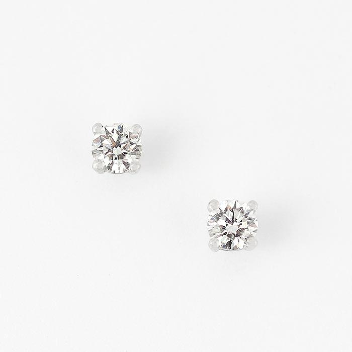 a pair of diamond stud earrings with round stones in a 4 claw setting and made in 18ct white gold