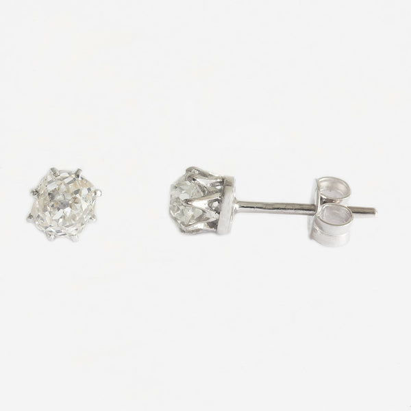 a white gold pair of stud diamond solitaire earrings with eight claws