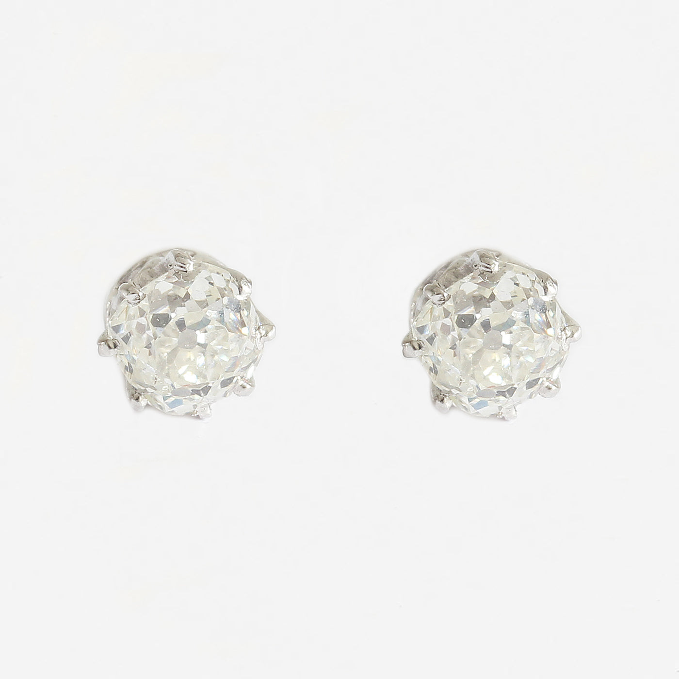 a secondhand pair of solitaire diamond eight claw set stud earrings