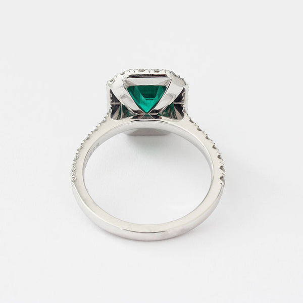 platinum ring with emerald and diamond cluster design marston barrett lewes