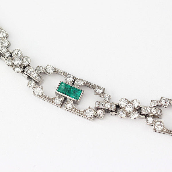 a french hallmarked emerald and diamond bracelet with platinum metal
