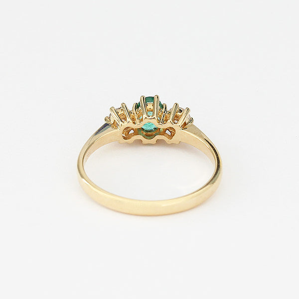 yellow gold emerald and diamond 3 stone ring