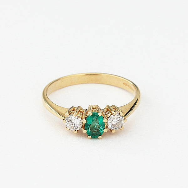 emerald and diamond 3 stone ring yellow gold m Marston barrett lewes