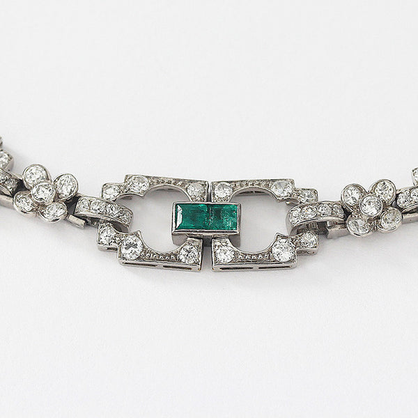 a diamond and emerald link bracelet set in platinum in art deco style and french hallmark