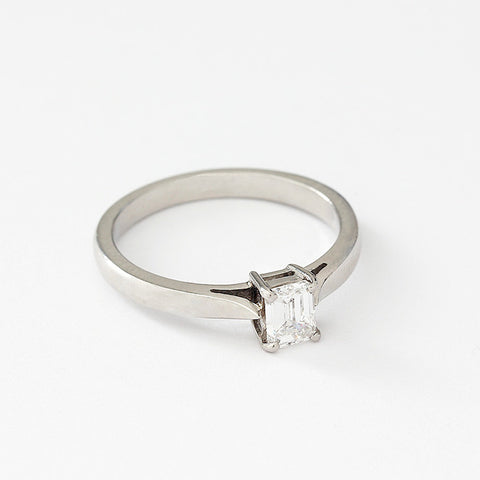 a single stone diamond engagement ring with emerald cut stone and set in platinum