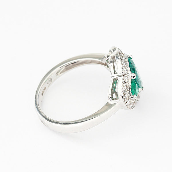 white gold emerald and diamond claw set cluster ring
