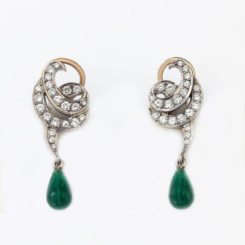 a beautiful pair of emerald and diamond drop earrings in white and yellow gold