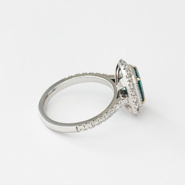 emerald and diamond cluster ring set in platinum
