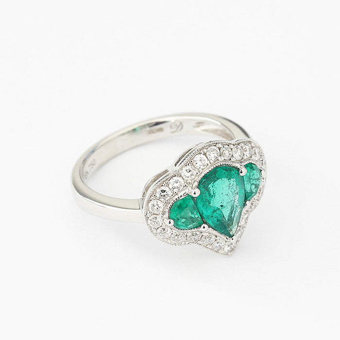 emerald and diamond pear shaped cluster ring in white gold