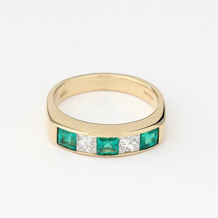 emerald and diamond half eternity ring in yellow gold