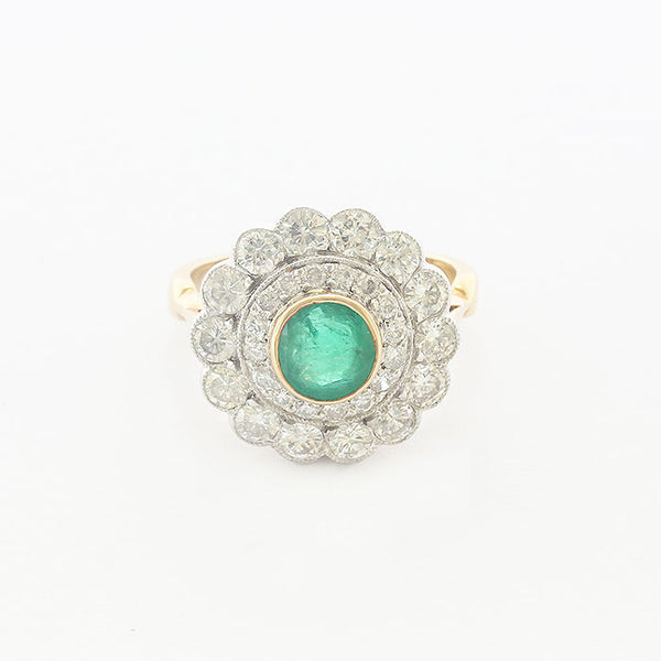 a preowned diamond and emerald cluster round gold ring