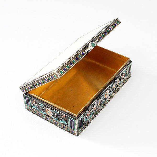 a stunning enamel and silver gilt trinket box with green stone thumb piece antique
