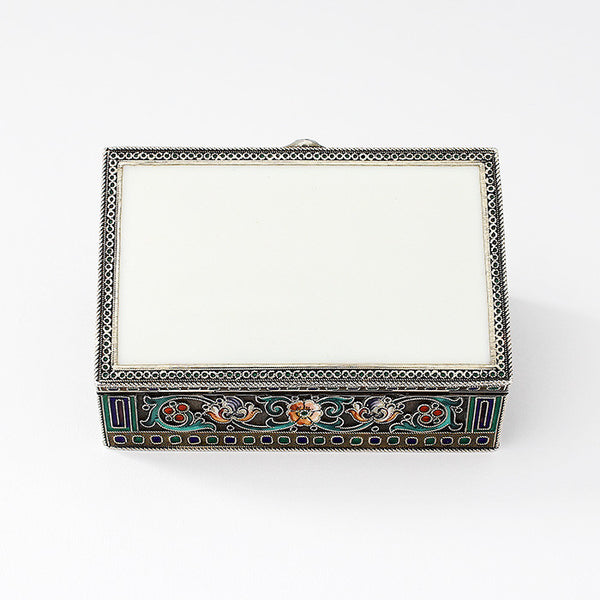 a silver gilt and enamel small trinket box with floral pattern and raised rope borders