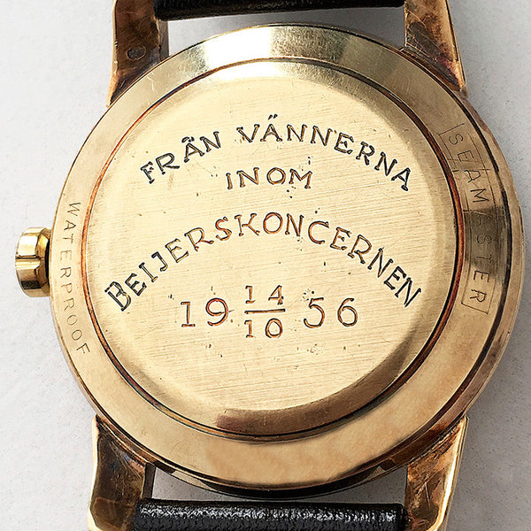 an omega seamaster gents watch dated 1956 with engraving on back leather strap and gold case