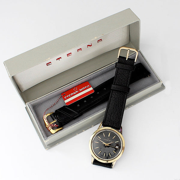 a gents eterna-matic watch with gold capped stainless steel case and leather strap with original box