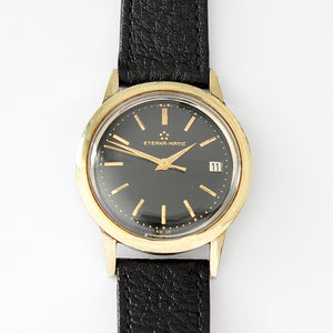 a vintage eterna-matic automatic watch with original box and buckle