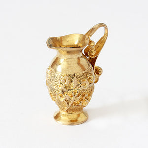 a large vintage ewer charm in yellow gold with hallmark