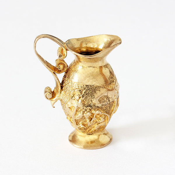 a yellow gold ewer jug charm with floral decoration vintage style