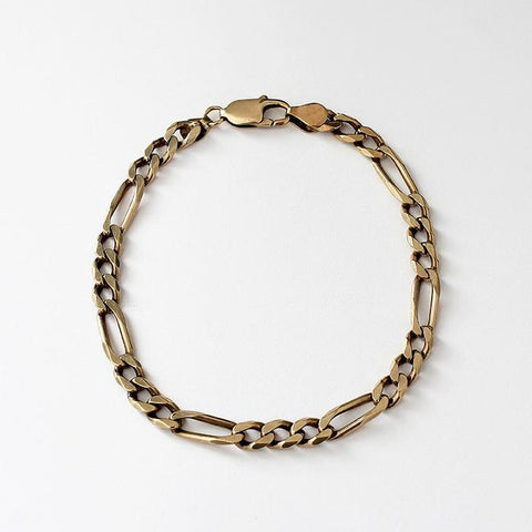 a secondhand gold figaro design bracelet with trigger clasp