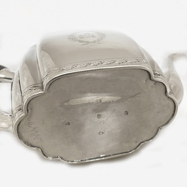 a george the third silver teapot with family crest dated London 1800