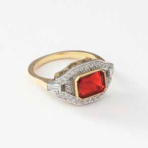 a fire opal and diamond unusual cluster ring in yellow gold